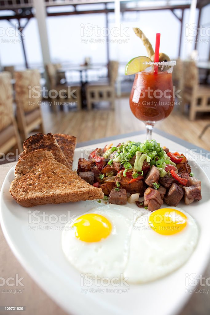 Prime rib hash with two eggs and toast. stock photo
