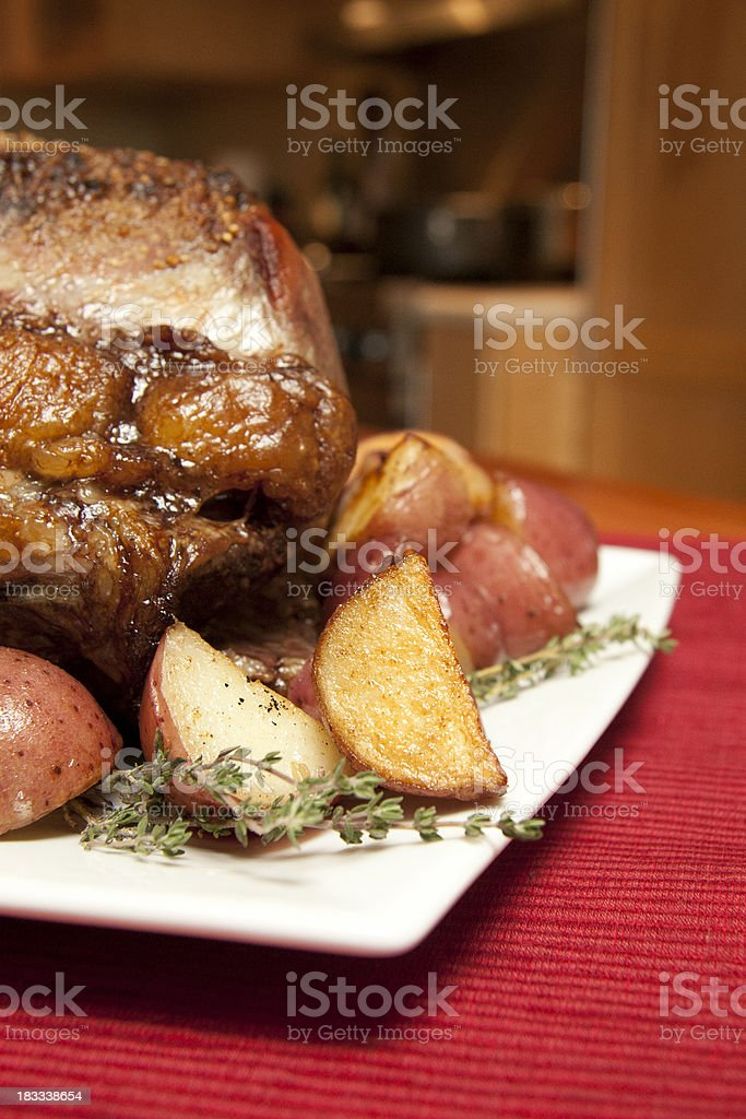 Prime Rib Roast with potatoes royalty-free stock photo