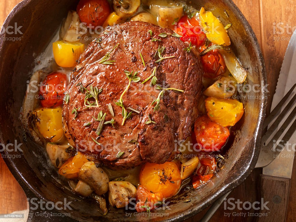 Prime Rib Steak with Tomatoes and Mushrooms stock photo