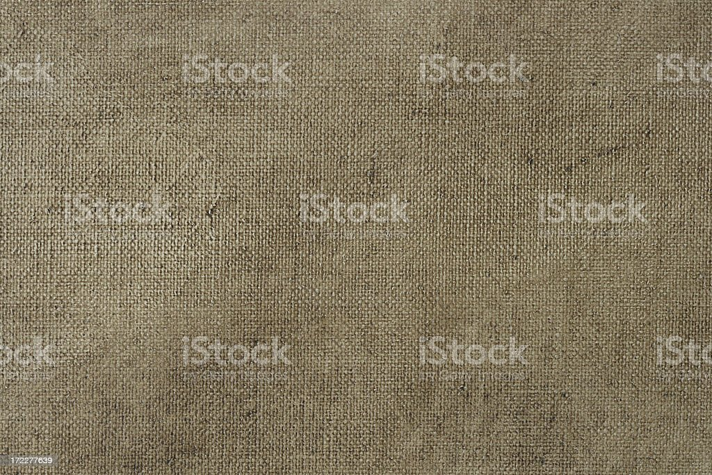 Primed linen canvas for oil painting with raw umber glazing royalty-free stock photo