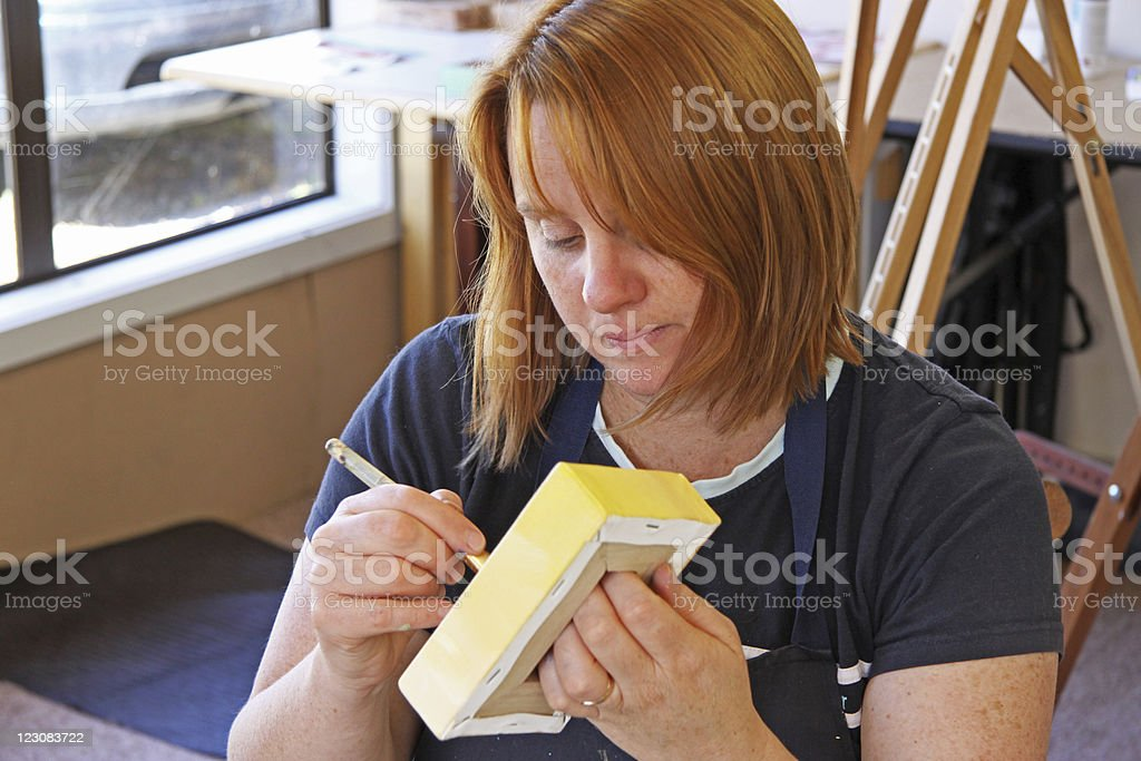 Priming the canvas stock photo