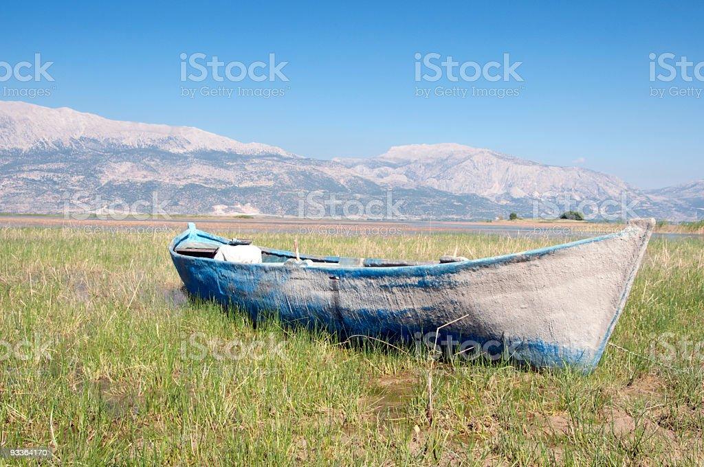Primitive fishing boat stock photo