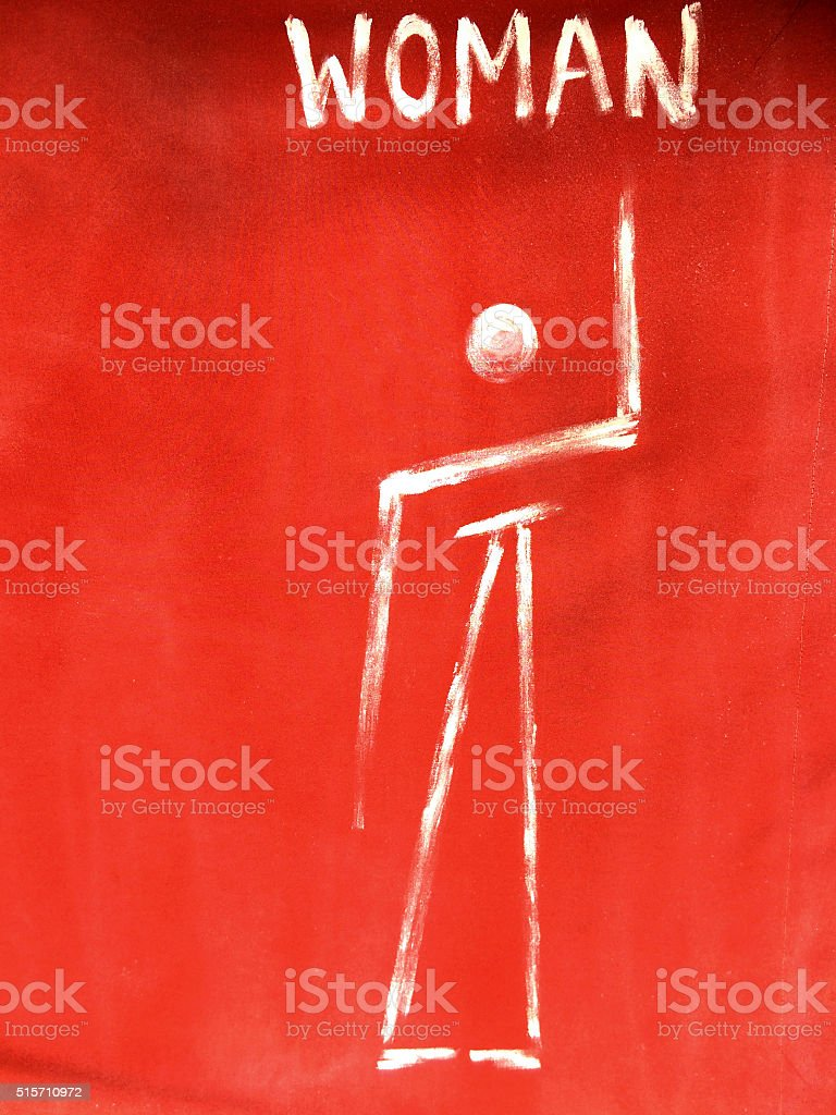 Primitive woman toilet sign stock photo