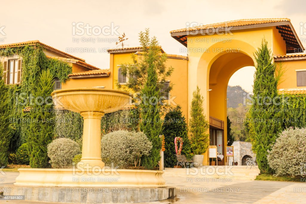 KORAT , THAILAND - MARCH 22, 2017 : Primo Piazza , the Italian style small town at Korat province in Thailand . The fountain at in front of Primo piazza stock photo