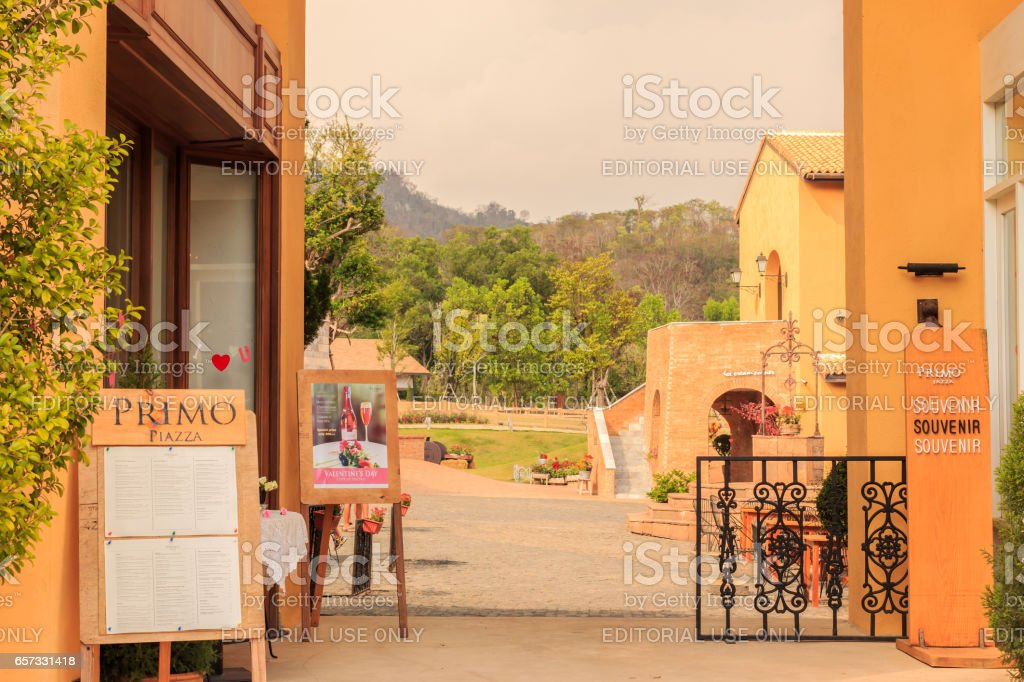NAKHON RATCHASIMA, THAILAND- MARCH 22, 2017 : Primo Piazza , the Italian style small town at Nakhon Ratchasima or Korat province in Thailand . At the Entrance to inside of Primo piazza . stock photo