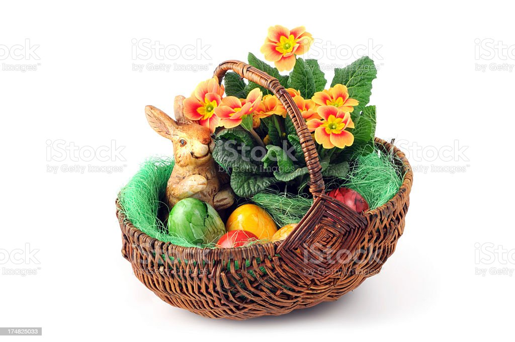 Primula Primrose with easter eggs in basket and bunny royalty-free stock photo