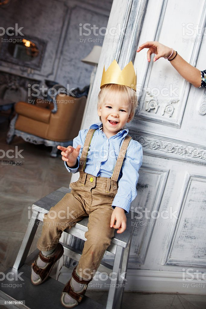 Prince cute baby smiling cheerful happy crown stock photo