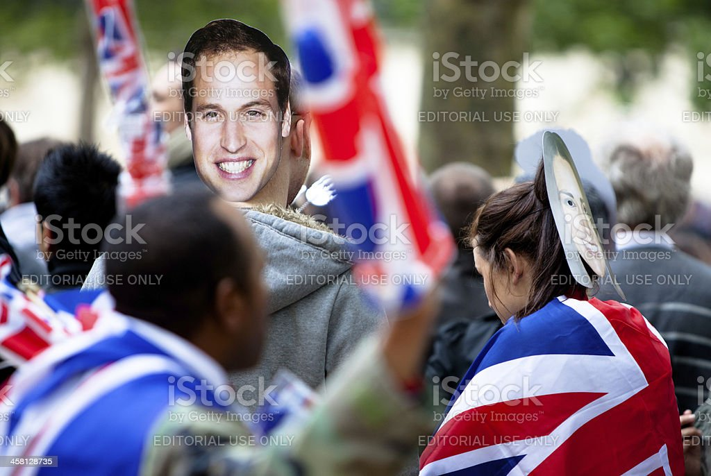 Prince William and Ms. Catherine masks at Royal Wedding royalty-free stock photo