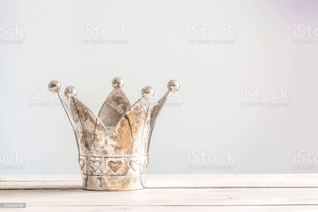 Princess crown on a wooden table stock photo