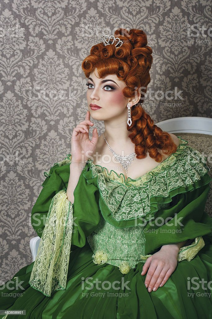 Princess in magnificent green dress stock photo