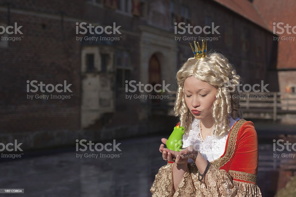 Princess kisses the frog royalty-free stock photo