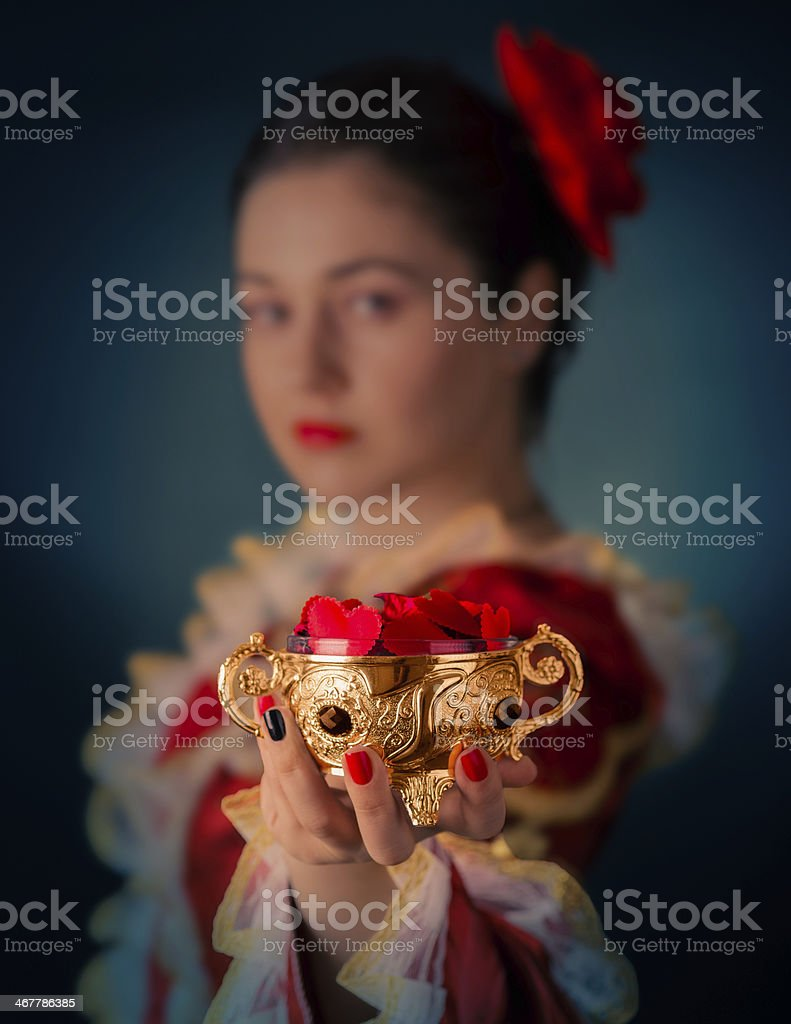 Princess Offering Heart Shaped Petals stock photo