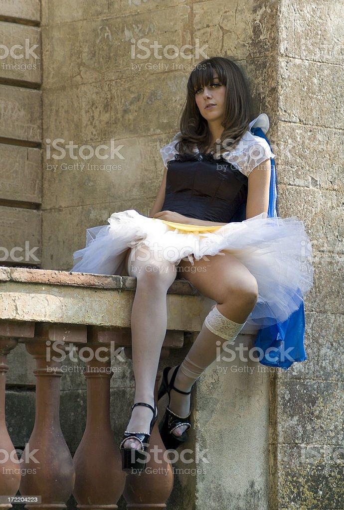 Princess sitting on a balustrade royalty-free stock photo