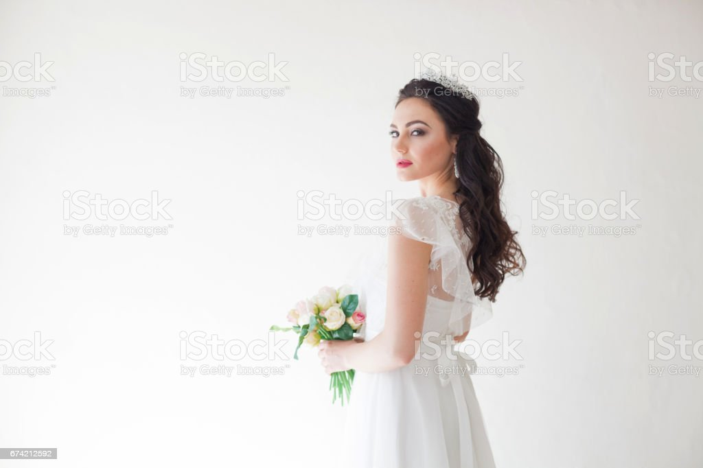 Princess with a Crown in white dress the bride stock photo