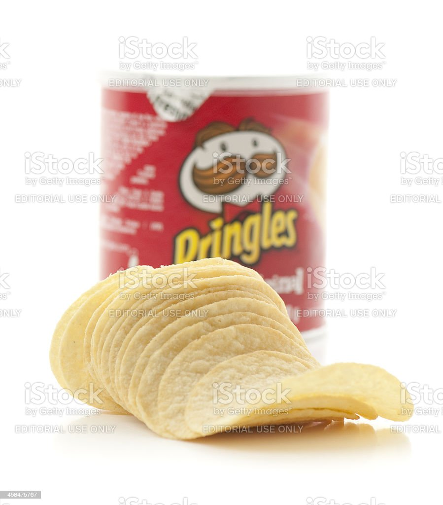Pringles potato chips in front of can on white royalty-free stock photo