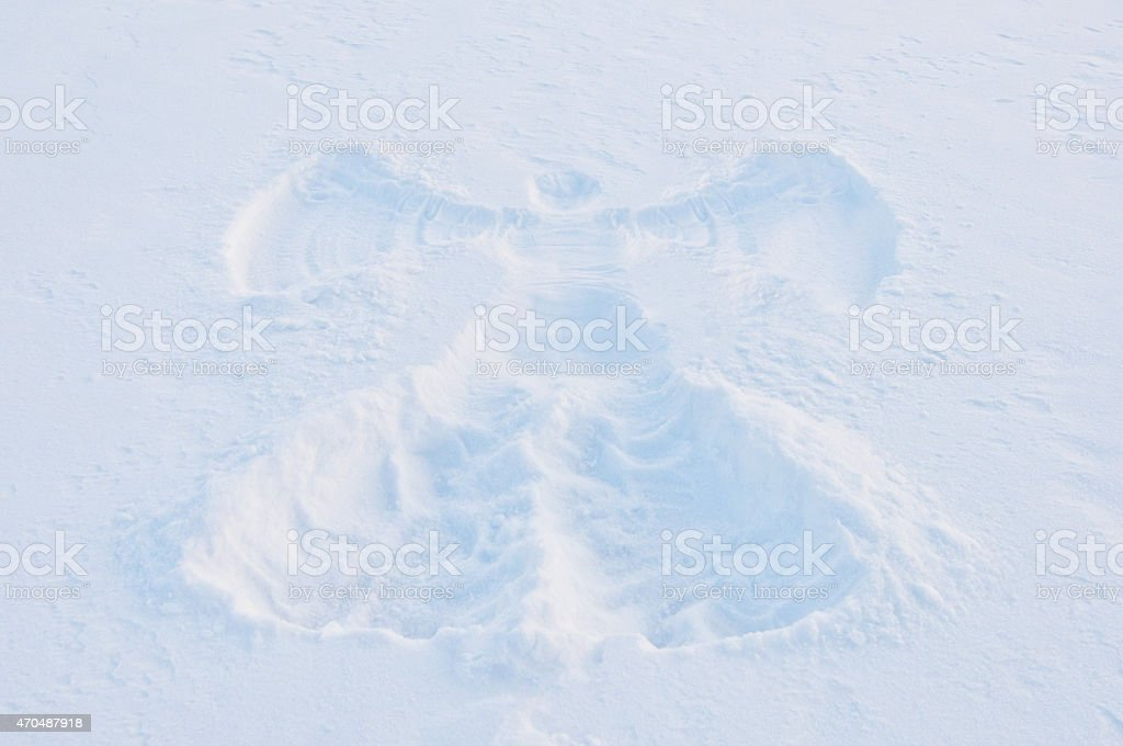 print of angel on the snow surface stock photo