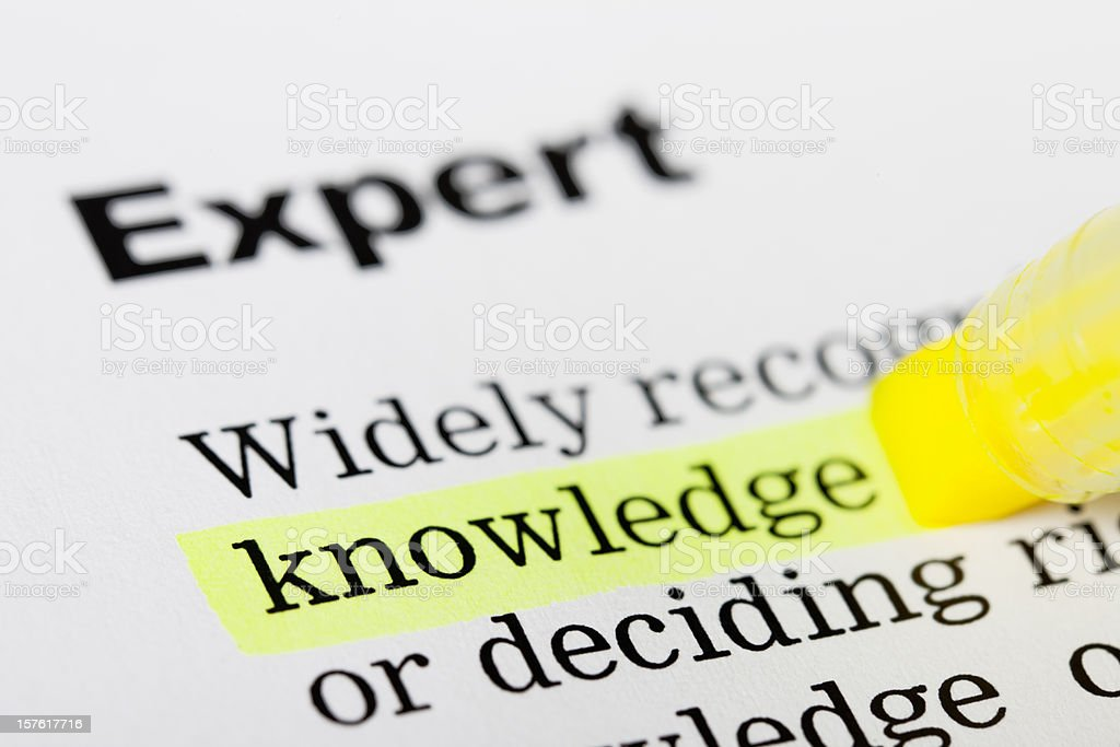 Printed page with 'knowledge' highlighted yellow royalty-free stock photo