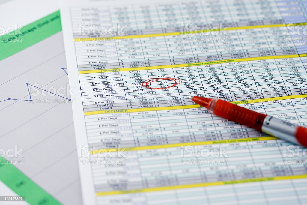 Printed spreadsheet tables, something highlighted in red pen royalty-free stock photo