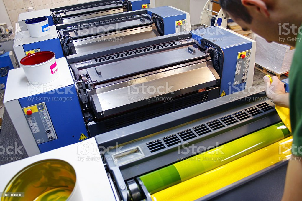 Printer distributes the ink in the printing press stock photo