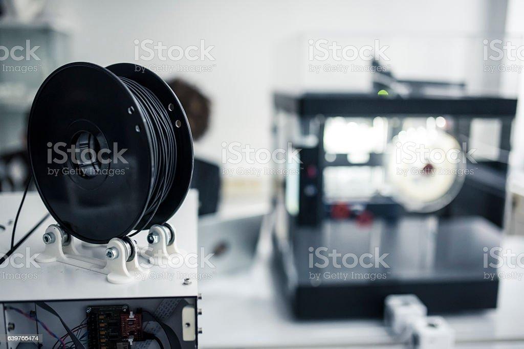 3D printer filament spools on the spot stock photo