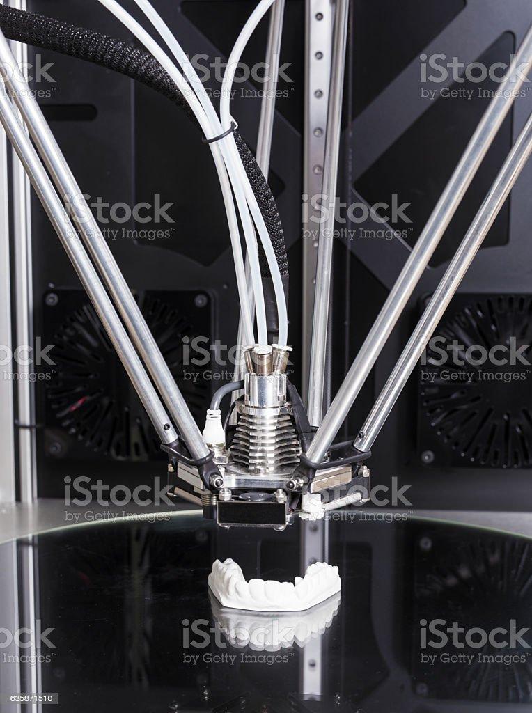 3D printer printing a teeth prototype stock photo