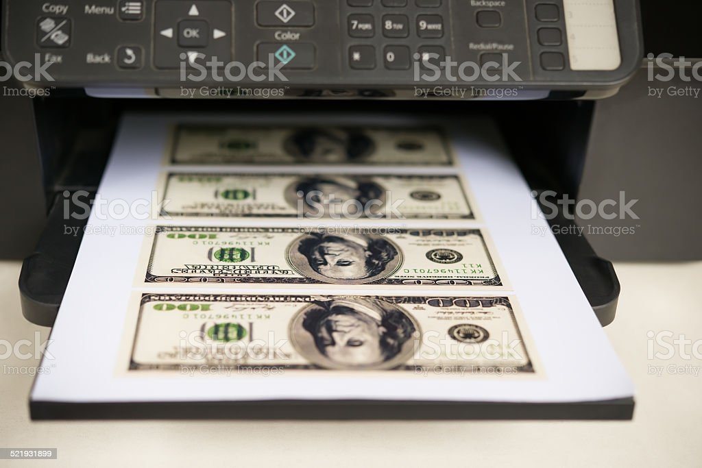 printer with USD paper currency coming out stock photo