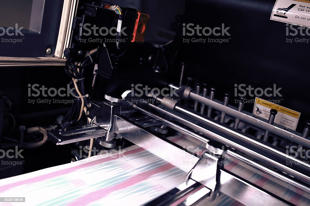 Printing machine during production output stock photo