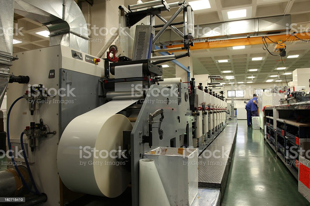 Printing machine with roll of paper in factory stock photo