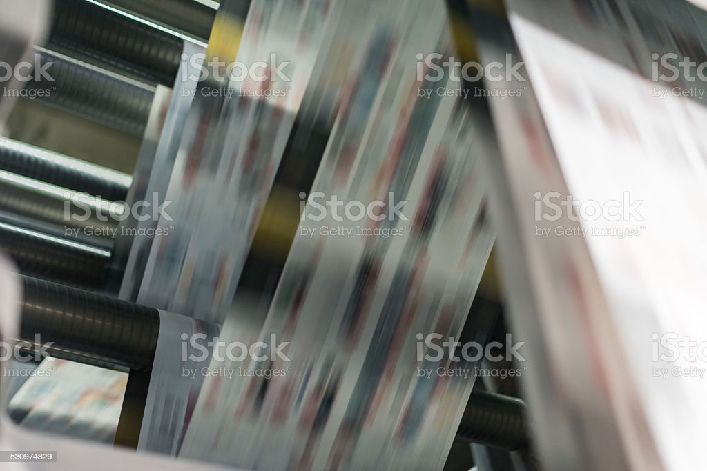 Printing newspaper on web press stock photo