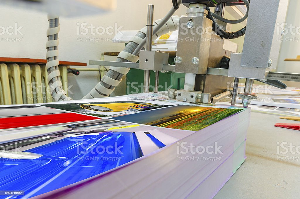Printing plant folding macine detail stock photo