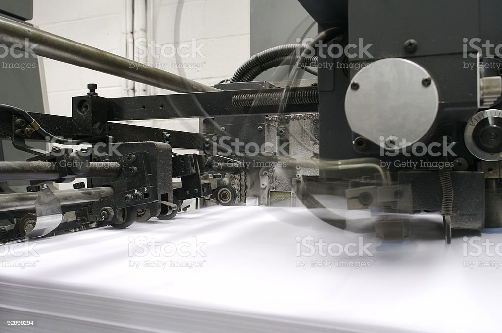 Printing Press Feeder In Motion... royalty-free stock photo