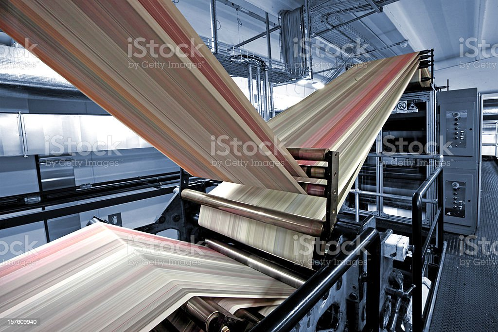 Printing press in blue royalty-free stock photo