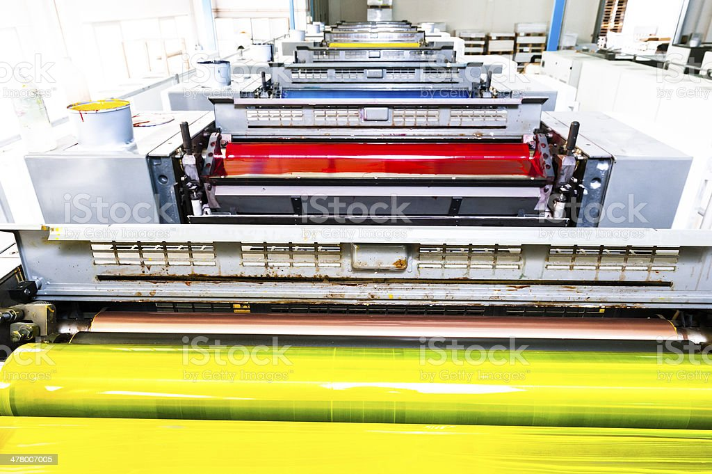 Printing Rollers of a CMYK Industrial 8-Colours Lithograph Printer stock photo