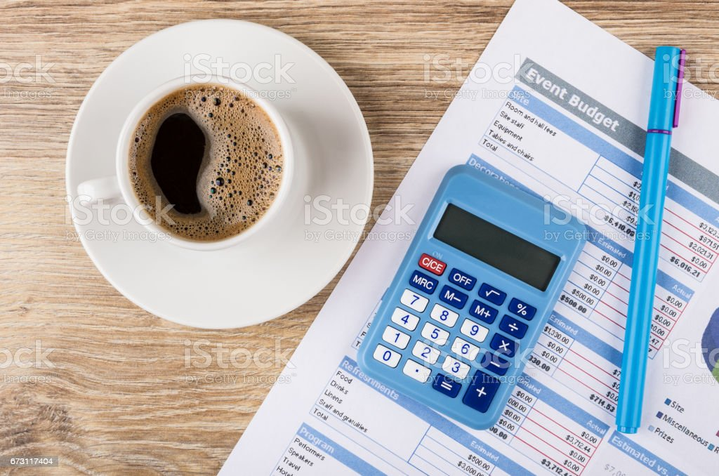 Printout of event budget, calculator, pen and coffee in cup stock photo