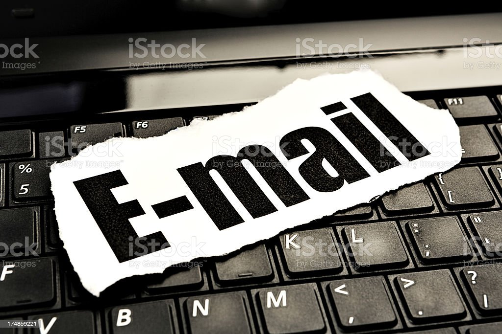 "Printout on keyboard reads ""E-mail"" - essential for modern communication royalty-free stock photo"