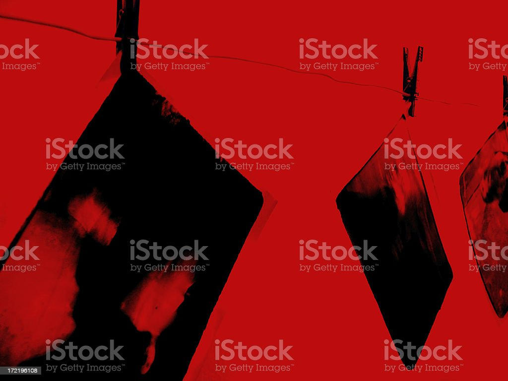 Prints Drying In Red Darkroom royalty-free stock photo