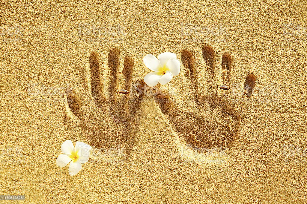 prints of love on the sand stock photo