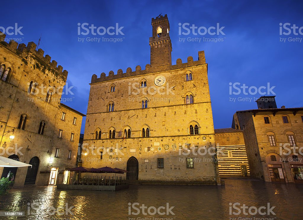 Priori Palace and Piazza on a Rainy Night in Volterra stock photo