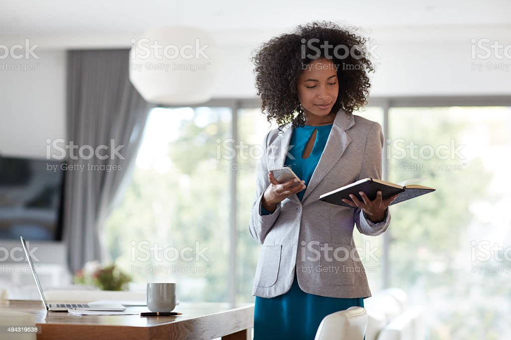 Prioritizing her tasks for the day stock photo