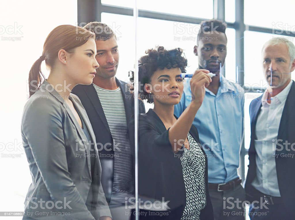 Prioritizing tasks for their team project stock photo