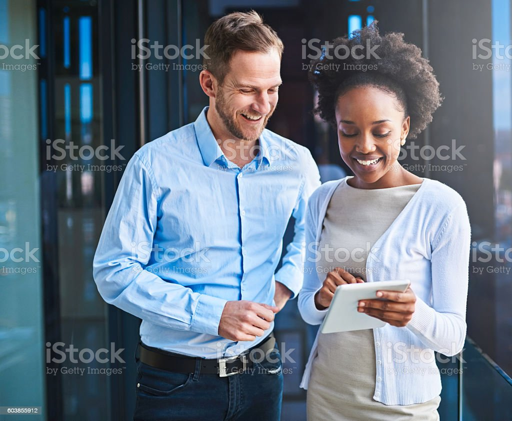 Prioritizing their goals for the project with technology stock photo