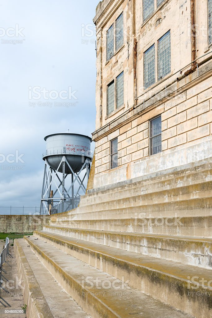 Prison cell block and water tower on Alcatraz island stock photo