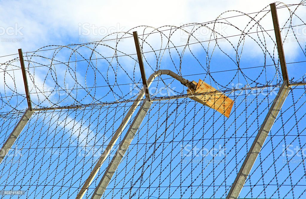 Prison fence stock photo