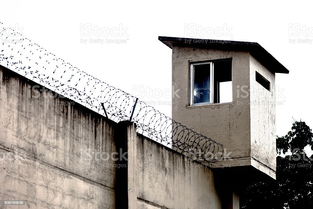 Prison wall - barbed wire stock photo