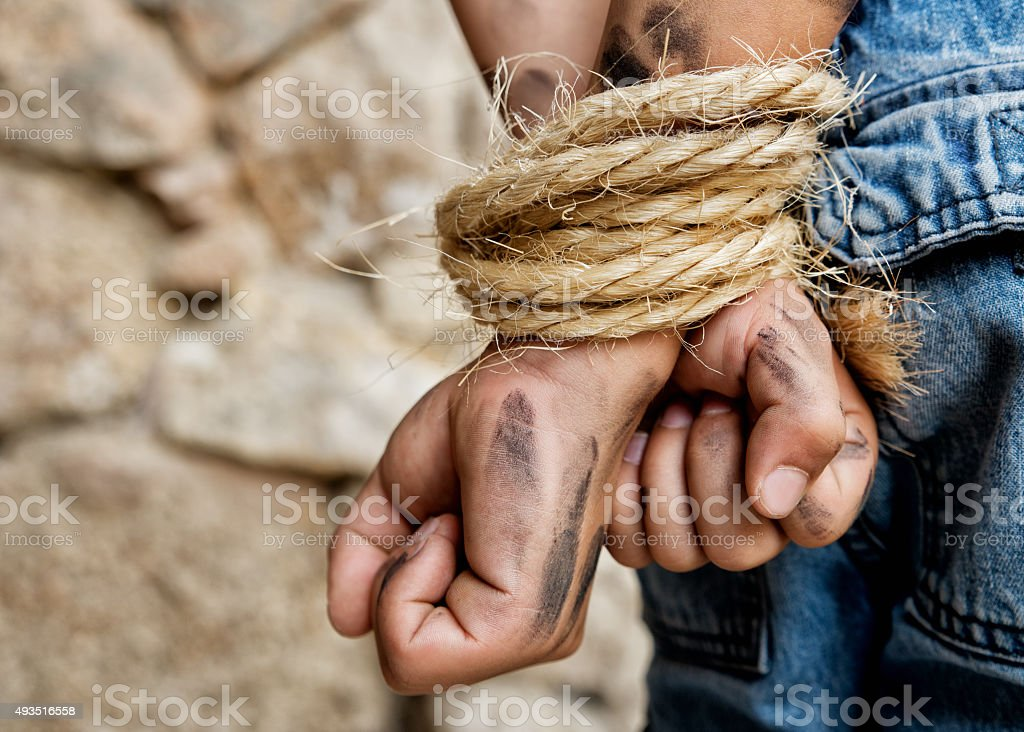 Prisoner bound with rope stock photo
