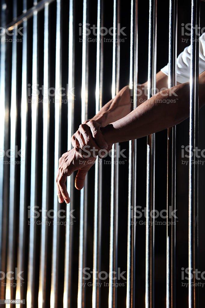prisoner in jail stock photo