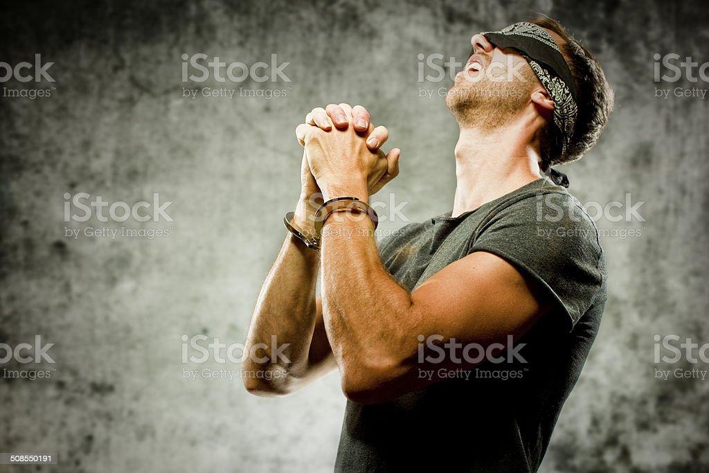 Prisoner praying stock photo
