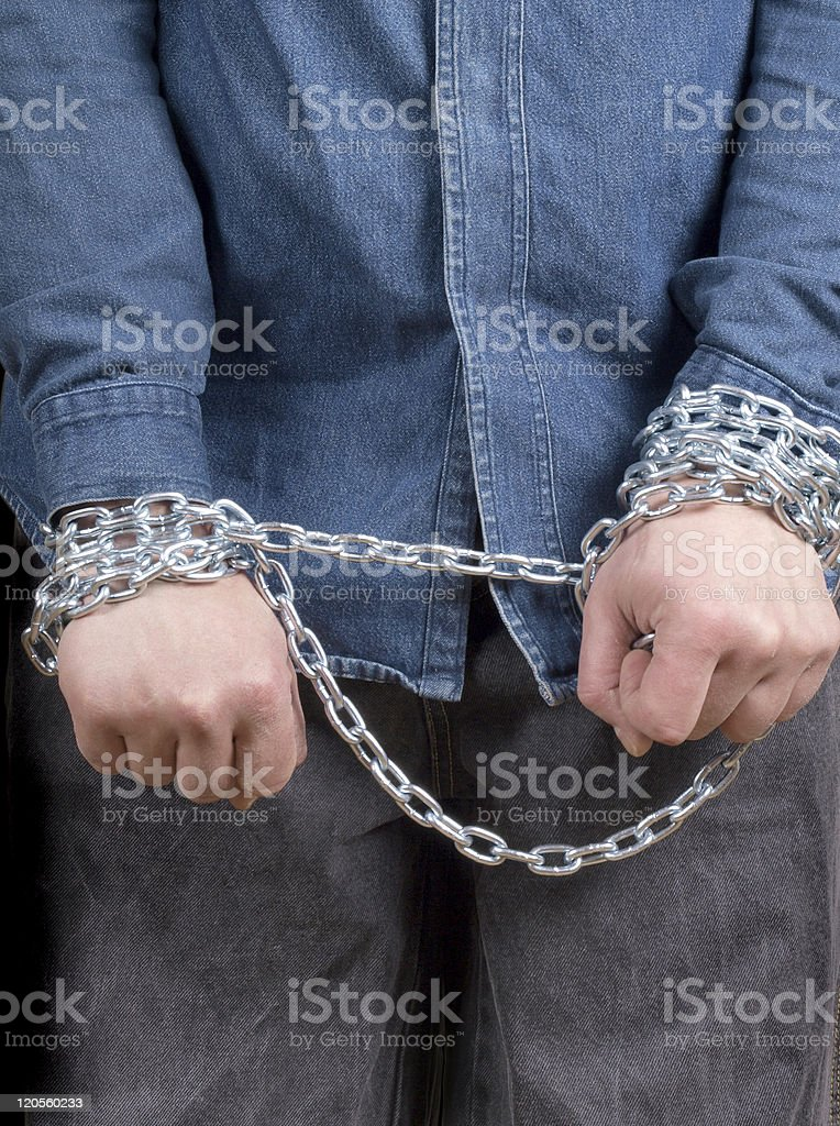 Prisoner with chain royalty-free stock photo