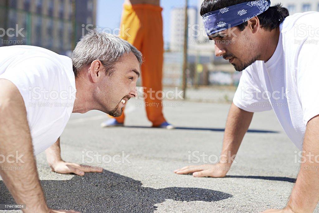 Prisoners doing push-ups stock photo