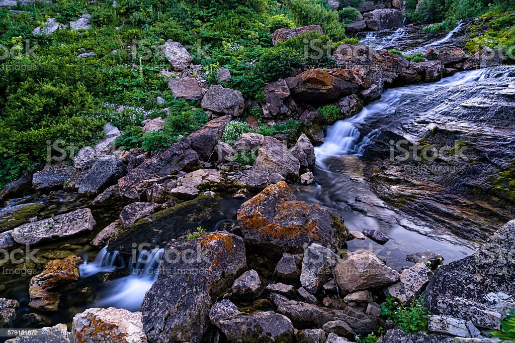 Pristine Mountain Creek Waterfall in Canyon stock photo